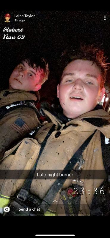 Captain Ryan Kuhn (left) and Firefighter Laine Taylor taking a short break after an interior attack.