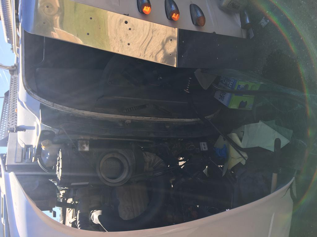 Engine compartment and cab of the dump truck.